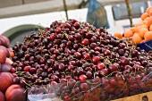 A heap of cherries at a market