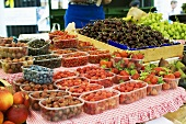 Fresh berries, cherries and grapes at a market