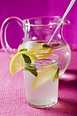 Lemonade with ice cubes and lemon balm