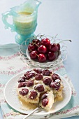 Cherry tart with icing sugar and custard