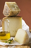 Three pieces of cheese, olive oil and salt