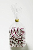 Cherry mint sweets in cellophane bag