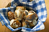 Assorted pretzel rolls in bread basket