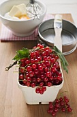 Redcurrants, baking ingredients and utensils