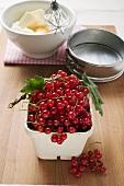 Redcurrants, baking ingredients and utensils