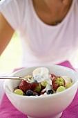 woman eating fruit muesli with yoghurt