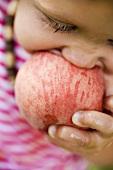 Child biting into juicy nectarine