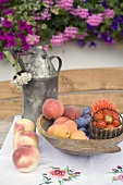 Summer fruit still life on table in front of house
