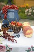 Summer fruit still life on table in garden