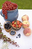 Summer fruit still life on table in garden
