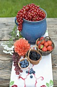 Summer berry still life on rustic table out of doors