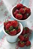 Fresh strawberries in small white pots