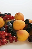 Fruit still life with apricots and berries