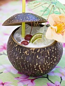 Pina Colada with cherries, lime and flower