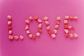 The word 'Love' written in small pink sweets