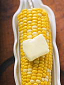 Corn on the cob with knob of melting butter (overhead view)