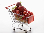 Assorted berries in toy shopping trolley