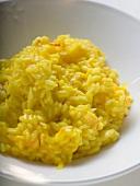 Saffron risotto on white plate