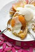 Apricot tart with vanilla ice cream and rose petals