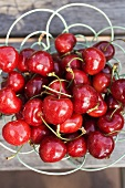 Fresh cherries in wire basket