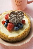 Cheesecake with fresh berries and chocolate heart