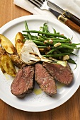 Beef steak with potato wedges, spring onion, beans & bacon