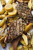 Grilled pork chops with fried potatoes and sweetcorn