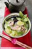 Chicken and lemon grass soup with lime, Thai basil (Asia)