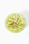 Half a lime, squeezed (overhead view)