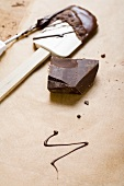Piece of chocolate, remains of couverture, baking utensils
