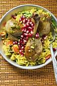 Chicken legs with saffron rice & pomegranate seeds (Asia)