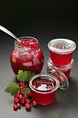 Raspberry jam, redcurrant jelly, redcurrants, leaves
