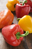 Yellow, orange and red peppers with drops of water