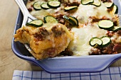 Polenta bake with mince and courgettes, portion on server