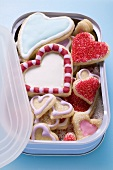 Assorted heart-shaped biscuits in biscuit box