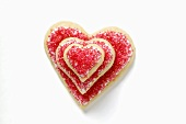 Heart-shaped biscuits with red sugar, in a pile