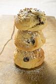 Three raisin scones with sugar, in a pile