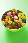 Coloured jelly beans in green bowl