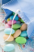 Sugared almonds in blue felt bag