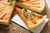 Carrot tart with parsley, a slice cut