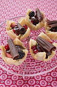 Yufka pastry tarts with berries and chocolate rolls
