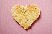 Pastry heart with flaked almonds and sugar