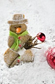 Spiced pastry snowman in winter landscape