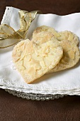 Pastry hearts with flaked almonds and sugar
