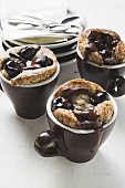 Chocolate and amarena puddings in espresso cups