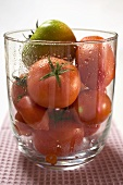 Different kinds of tomatoes in a glass bowl