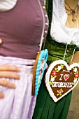 Two women with Lebkuchen hearts (Oktoberfest, Munich)