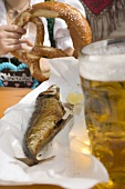 Steckerlfisch (fish on stick), beer, pretzel (Oktoberfest, Munich)