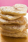 Almond hearts with sugar, in a pile