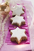 Cinnamon stars on purple paper